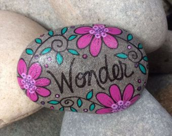Hand-painted, one-of-a-kind Happy Rock - Awesome. This beautiful one-of-a-kind river rock was found on the banks of the Oconuluftee River in western NC. Happy Rocks just make you want to smile! What to do with a Happy Rock? Add a cheerful touch to your home decor... brighten your garden/potted plants... use as a paper weight... use during meditation... or make someone else smile and give this as a gift for any occasion. This Happy Rock measures approximately 6 1/2 x 3 1/2 If y...