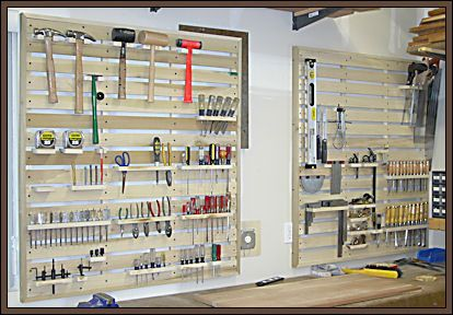 Wall organizer in garage or workshop - looks like it could easily be made of pallets for little or no cost.