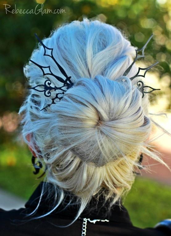 Platinum white hair. Sock bun. Clock hand hair picks. Pastel hair.Like the clock hair picks. Really pretty.