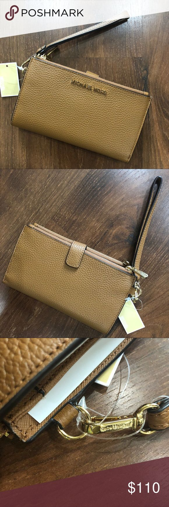 Michael Kors wristlet wallet cell phone acorn NWT Michael Kors wristlet! Beautiful acorn (brown) soft pebble leather Snap closure Removable wrist strap  Fits iPhone 7plus 8 plus and iPhone X. Will also fit smaller phones Two large zipper pockets 6 credit card slots 1 ID slot 2 slip pockets  I am open to reasonable offers but please be mindful this item is already priced below retail, sellers fees, condition (NWT) and brand when offering. Same/Next day shipping! ✈️ Questions, please them…