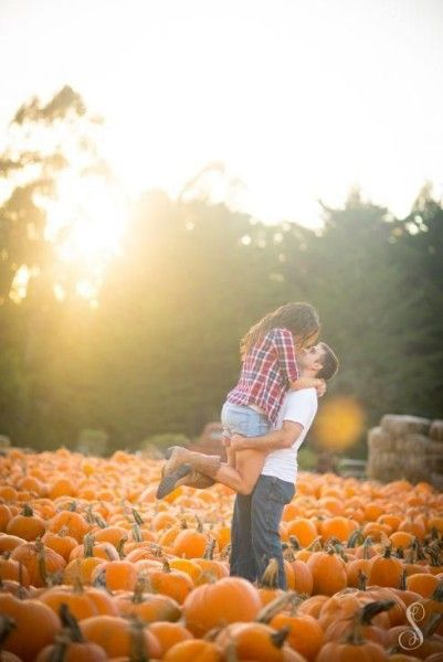 Fall Engagement Photo Ideas - Hug in a Pumpkin Patch