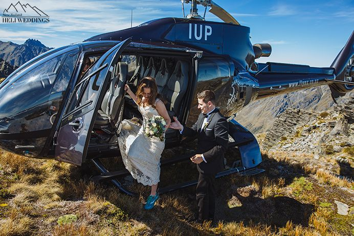 Bride getting out of helicopter