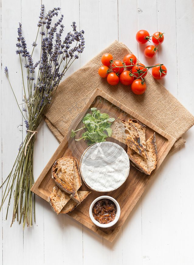 Camembert cheese and toast on a wooden board
