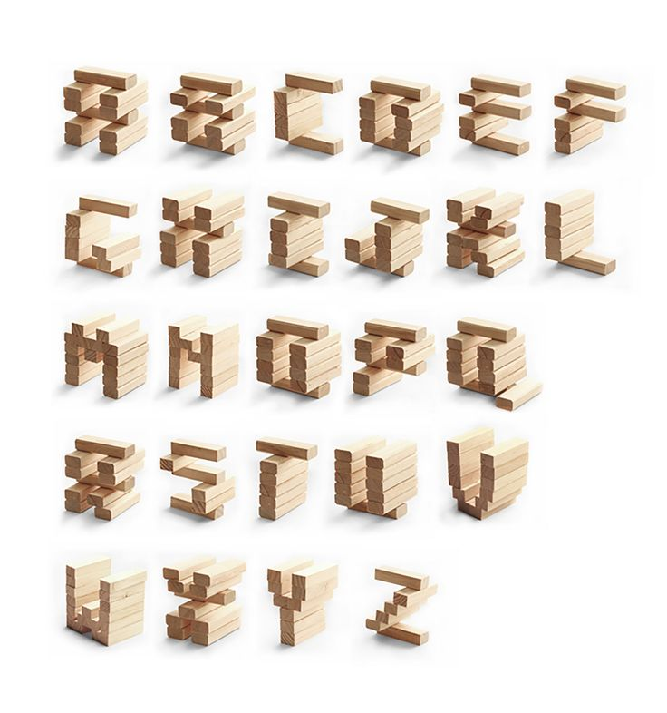 3D Typeface made out of Jenga game blocks challenging the illusion of balance.