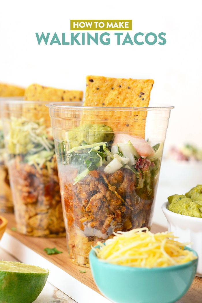 How to Make Healthy Walking Tacos - Up your walking taco game with my favorite Way Better Snacks, lean ground turkey taco meat, and a delicious kale slaw topped with all of your favorite fixings!