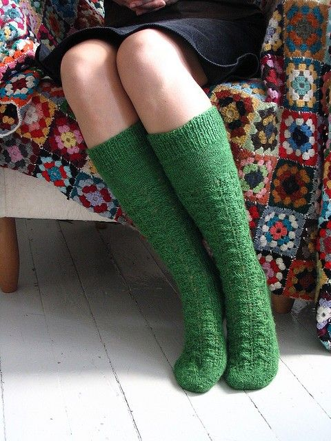 handmade green socks and crocheted blanket.