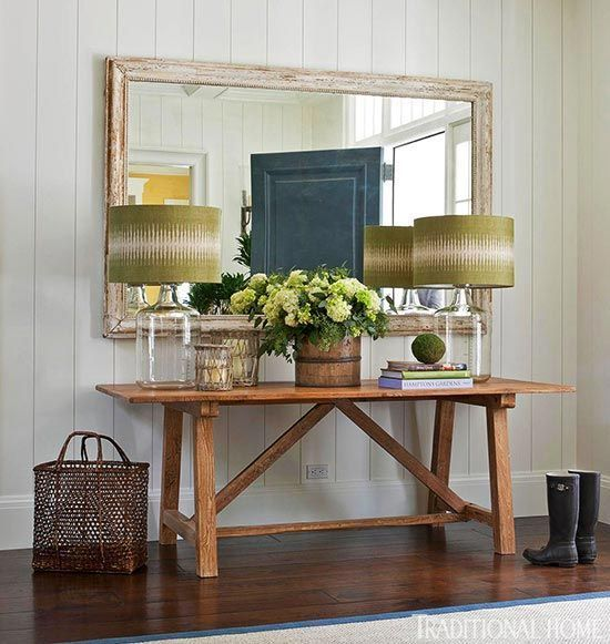 A Simple Side Table, Glass Lamps, And Large Mirror Invite Guests In To This