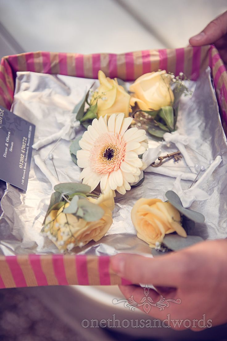 Wedding button holes with key by Beyond The Gate wedding florist. Photography by one thousand words wedding photographers