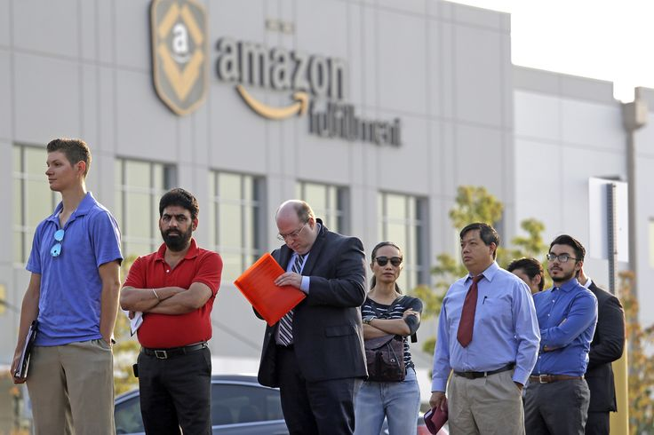 Applicants wait in line to enter a job fair, Wednesday, Aug. 2, 2017, at an Amazon fulfillment center, in Kent, Wash. (Elaine Thompson/AP)