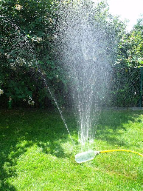 Make your own sprinkler out of a 2-liter bottle!  Fun craft for kids.