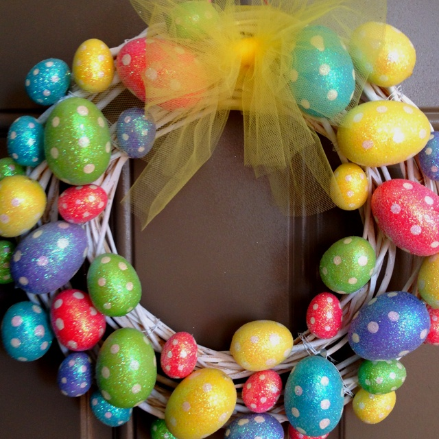 Easter wreath! 2 Dollar Tree wooden wreaths painted and wired together, foam Easter eggs, a little hot glue, and some tulle.