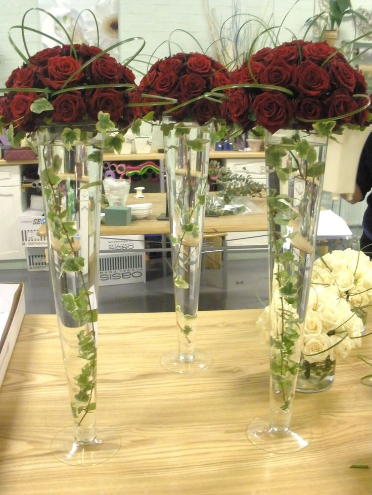 Red Roses In Tall Vases With Ivy Dont Like The Stem Loop De Loops Over