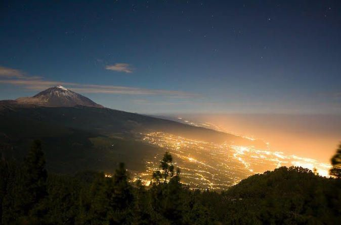 Mt Teide Volcano Tour by Night See the stars from Tenerife's Mount Teide, on a 4.5-hour evening tour from southern Tenerife! The dormant volcano — Spain's tallest — lies at the heart of the UNESCO-listed Teide National Park, and boasts some of the island's best vantage points. Watch over the rocky island terrain, and gaze at the starry night sky to learn about the constellations from a local guide. Leave your southern Tenerife hotel by air-c...