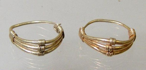 Roman gold earrings, 1st-3rd century A.D.  Circular design triple banded extensions on topside, 1.6 cm wide. Private collection