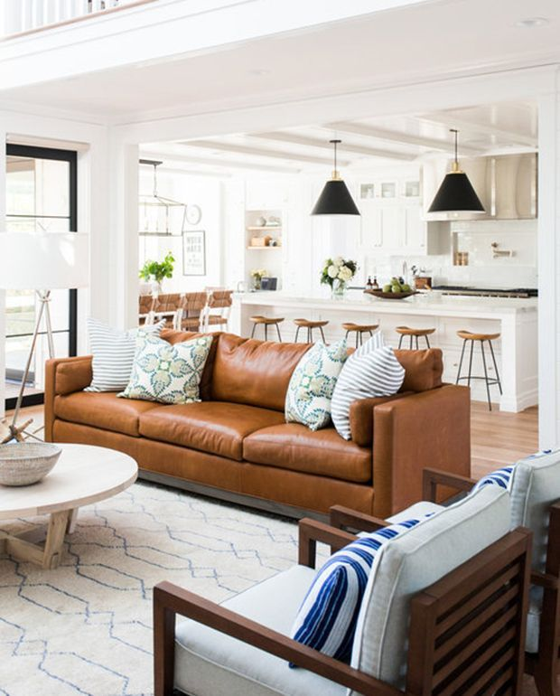 Salt Lake City-based design firm Studio McGee seems to have perfected the use of tan leather sofas in their clients' homes.