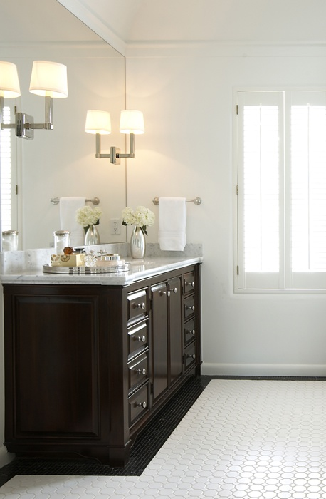 black glossy cabinet, sconces on mirrors. Ashley Goforth Design