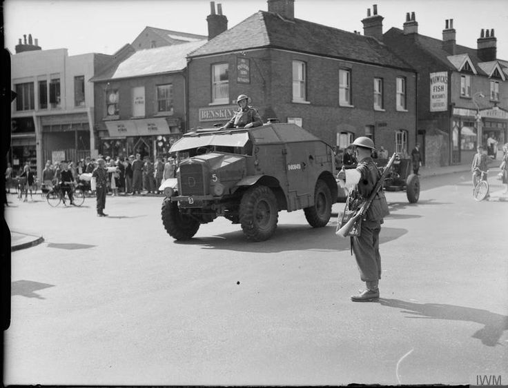 Morris Quad and 25-pdr field gun passing through a town 'somewhere in England', 28th August 1940.