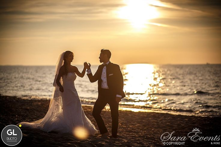 A romantic sunset is the backdrop to a dance on the beach