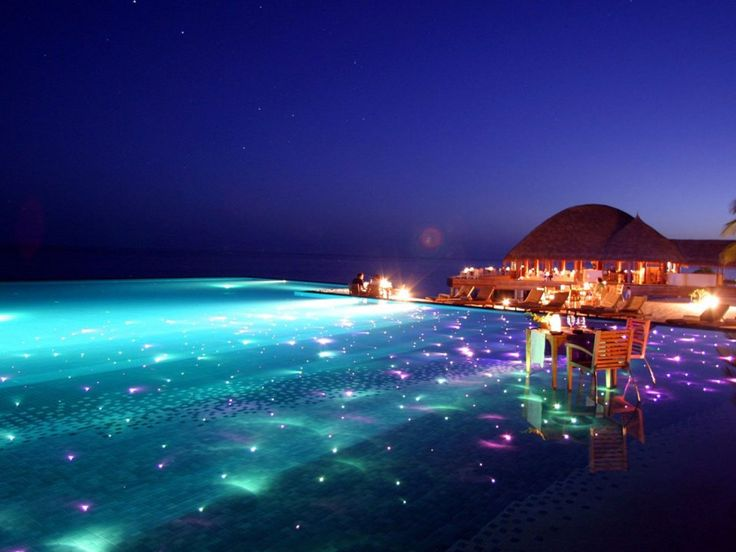 For a breathtaking evening swim, go to the Huvafen Sushi resort in the Maldives where the pool is covered in colored lights that twinkle beneath the surface