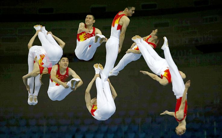 China's Tu Xiao competes in the men's trampoline event during the gymnastics competition at the Namdong Gymnasium Club during the Asian Games in Incheon