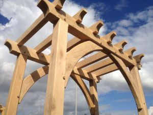 The March of the Pergolas. Handspring Design in Sheffield have just finished a series of 8 large oak pergolas and refurbished and remounted a Cumbrian Slate sign for Affinity Sutton Housing Association in Leicester. The green oak pegolas where all constructed using traditional timber framing techniques – draw doweled mortice and tenon joints with large curved braces.
