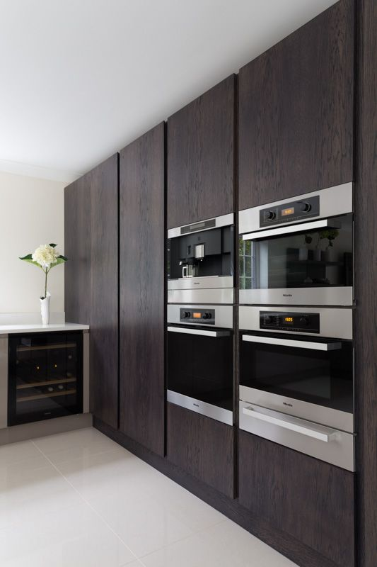 Stained Oak Larder Units and Oven Housing. Miele Appliances.