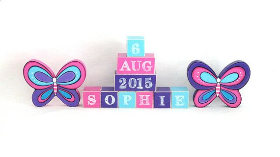 Butterfly wooden block set. Personalised Wooden Blocks make the perfect addition to any nursery. Place the wooden baby name blocks on a bookshelf, dresser or use them as a wooden toy. Custom baby blocks also make a wonderful new baby gift that can double as a baby photo prop. Wooden baby name blocks can be custom coloured to match you nursery decor.  * Two options available 1. Wooden Name and wooden shapes. 2. Wooden Name, DOB and wooden shapes. Every block is hand made and painted. Your…