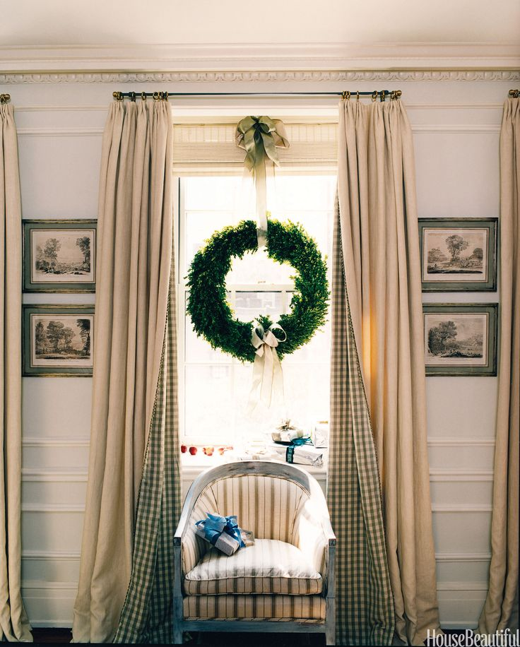 Wreaths aren't just for front doors. Designer Libby Moulton hung one in a window with pretty ribbon for a simple and elegant look for a Manhattan apartment. Curtains are lined with Chelsea Editions sage check. The chair is covered in a Rogers & Goffigon brown-and-cream stripe.   - HouseBeautiful.com