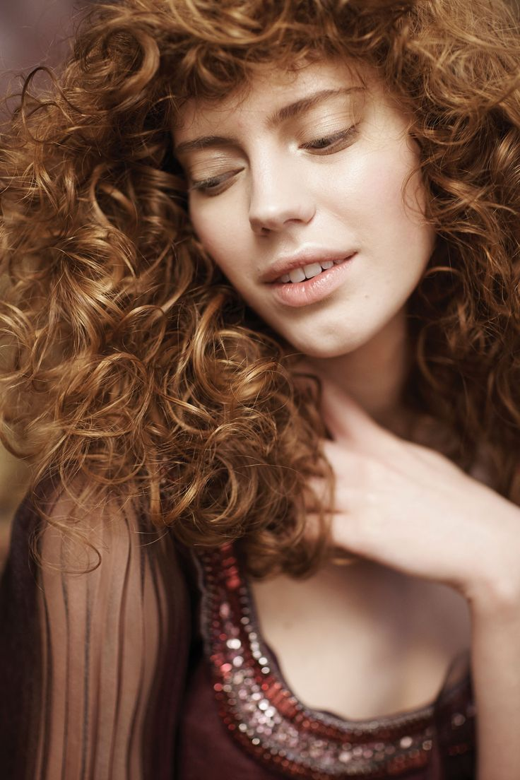 We love a honey brown shade of Aveda color paired with beautiful wild curls.