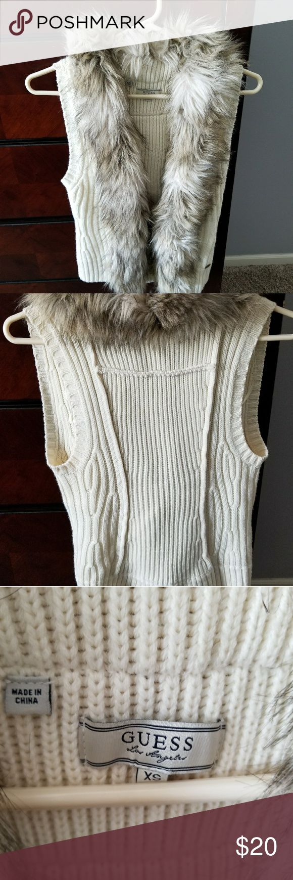 Guess fur trimmed vest Adorable fur trimmed cream vest by Guess. Slight stain in fur trim, not noticable (pictured) Guess Jackets & Coats Vests