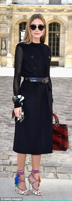 Tres chic: Also seen at the show was fashion icon Olivia Palermo who styled up her dark ensemble with a red handbag and colourful shoes