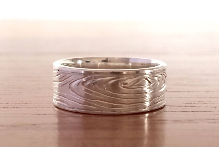 A personal favorite from my Etsy shop https://www.etsy.com/listing/536573640/wood-grain-nature-wedding-ring-band