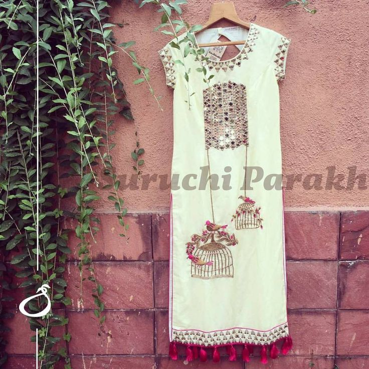 The very pretty birds and cages design with some gorgeous mirror work handcrafted over this lovely straight kurta and paired with pallazo pants.  14 May 2017