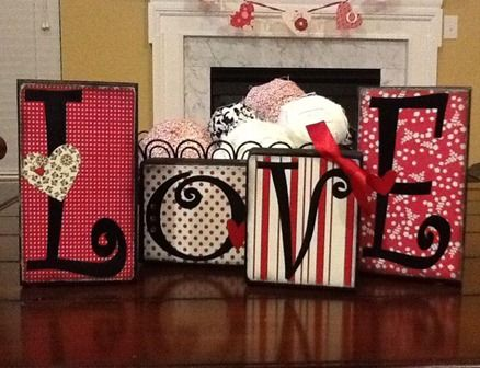 Wood blocks decorated with scrapbook paper and vinyl