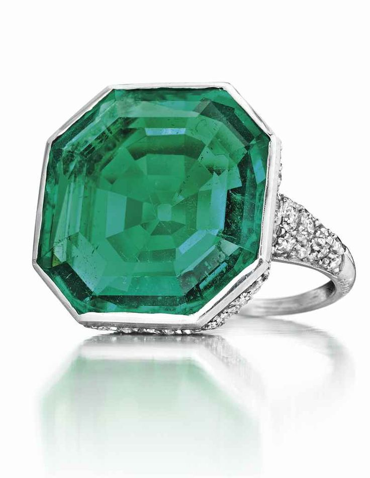 An Art Deco Colombian octagonal-shaped emerald and diamond ring, Cartier