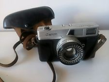 Camara de fotos Canon muy antigua con funda original
