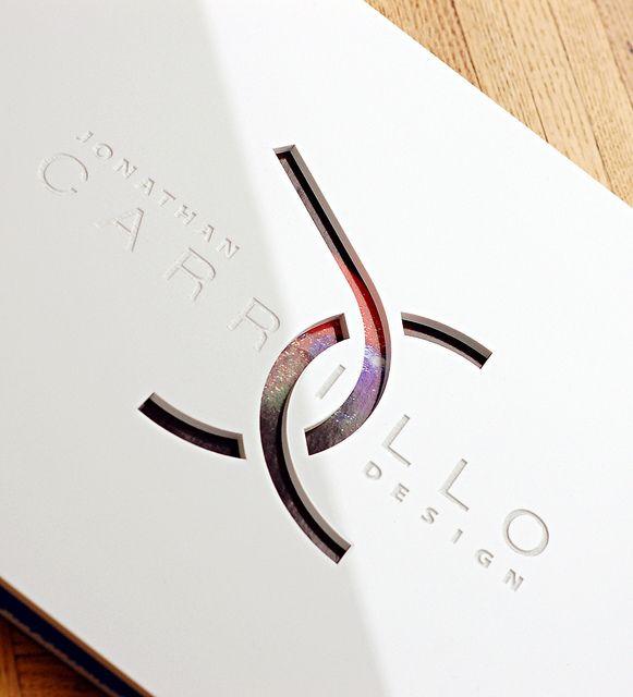 Custom white acrylic portfolio with engraving and diecut treatments