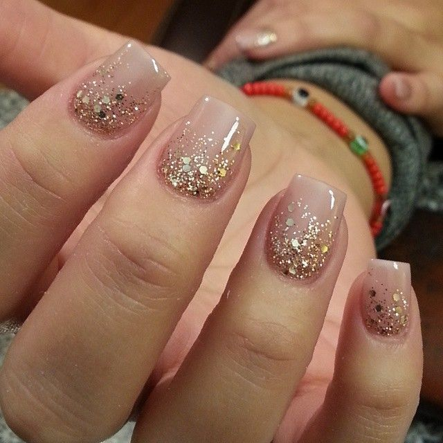 Nude nails with gold glitter