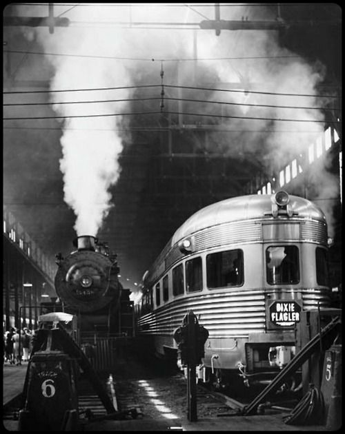 U.S. 1940. The Dixie Flagler train somewhere between Chicago and Miami. Metallic and smoky scene.