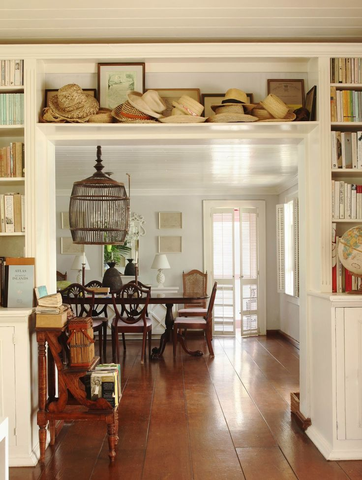 Love the wide floorboards & the shelves over the doorway piled with straw hats ~ very British Colonial ~ ROOMS THAT INSPIRE BY THE SEA