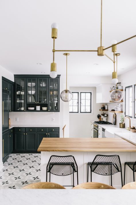 white cabinets | dark blue green cabinets | floor tile | butcher block counter | tall chairs | brass light fixture