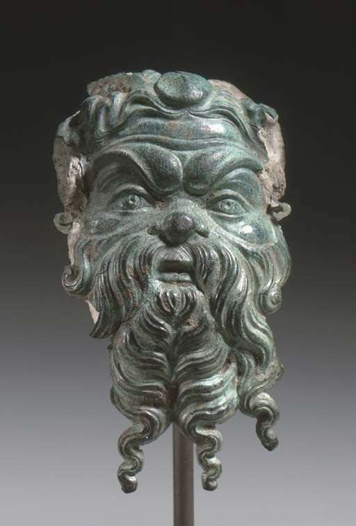 A GREEK BRONZE PAN APPLIQUÉ -  CLASSICAL PERIOD, CIRCA 4TH CENTURY B.C.
