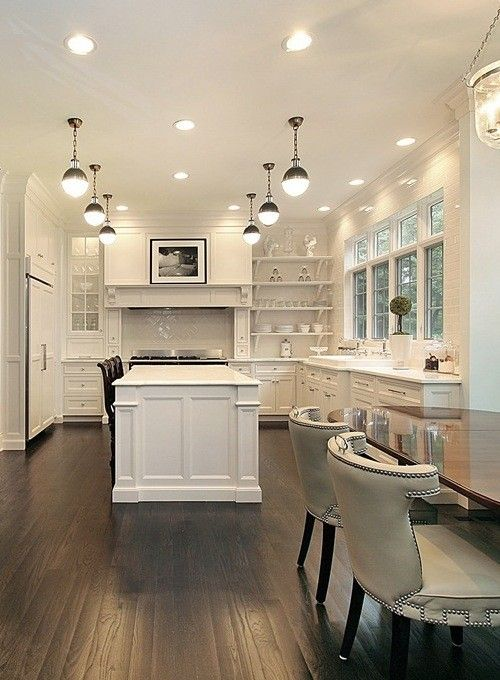 white with dark floors | multiple pendants | open shelving