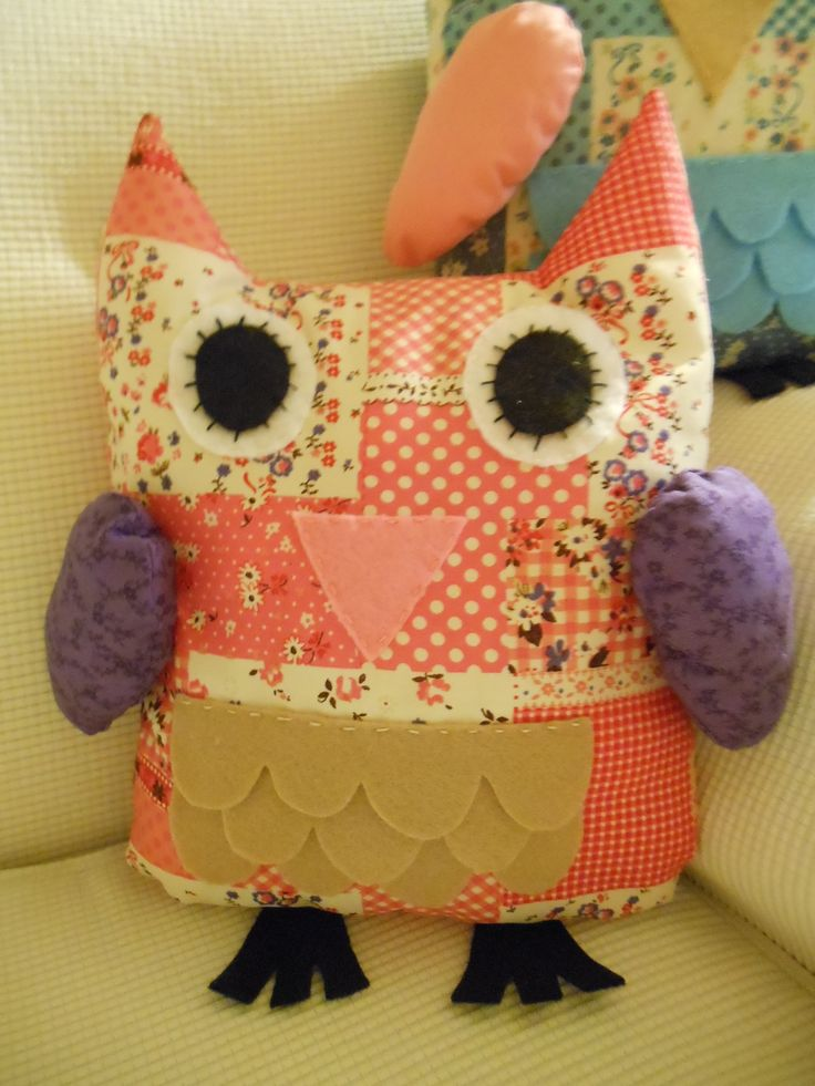 Large Hoot owl in pink and purple.