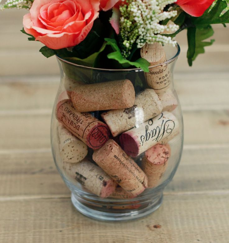 This cute, classy, and very unique cottage chic piece will be perfect for any wine lover. Filled with actual used wine corks. Includes: - Large Coral and Cream Rose - Small Coral Roses - Lime and Crea