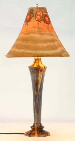 A delightful wood turned lamp and it's lampshade: also turned from wood.