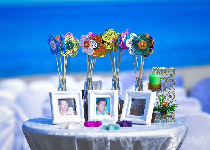 Commemorative Table.  Celebrate your wedding with your departed loved ones through a commemorative table with their best pictures on it.