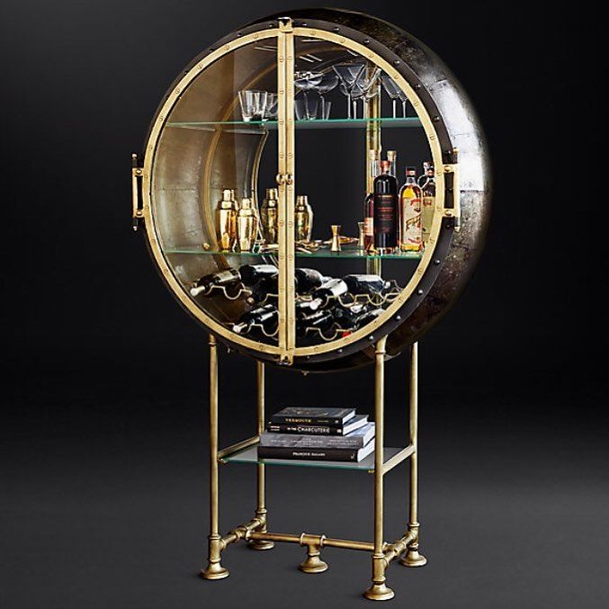PORTHOLE BAR $2655  REGULAR $1991 MEMBER Modeled on a 1920s industrial iron sphere our Porthole Bar evokes cocktail hour on the high seas. Set atop a pipework base its dramatic glass door is edged in metal with exposed rivets and features a mirrored interior. #bar #bartender #cocktails #drinks #cocktail #pub #drink #mixology #restaurant #beer #liquor #drinkup #thirsty #vodka #mixologist #beers #drinking #slurp #happyhour #wine #alcohol #thirst #lounge #cocktailbar #rum #бар #whiskey #gin…