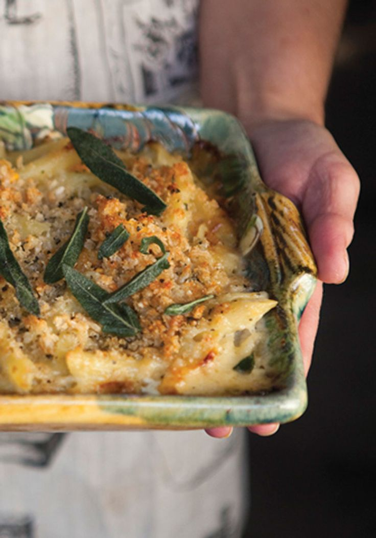 """With roasted butternut squash and sage mixed in to the pasta and cheese sauce, plus a sage-breadcrumb topping, this casserole from chef Mitch Rosenthal's book """"Cooking My Way Back Home"""" has a delightful balance of textures."""