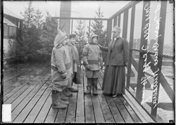 Portrait of superintendent of schools Mrs. Ella Flagg Young standing with students outdoors at the Mary Crane Nursery, an open-air school, located at 782 West Cabrini Street, 1910. Photograph from the Chicago Daily News. DN-0008011